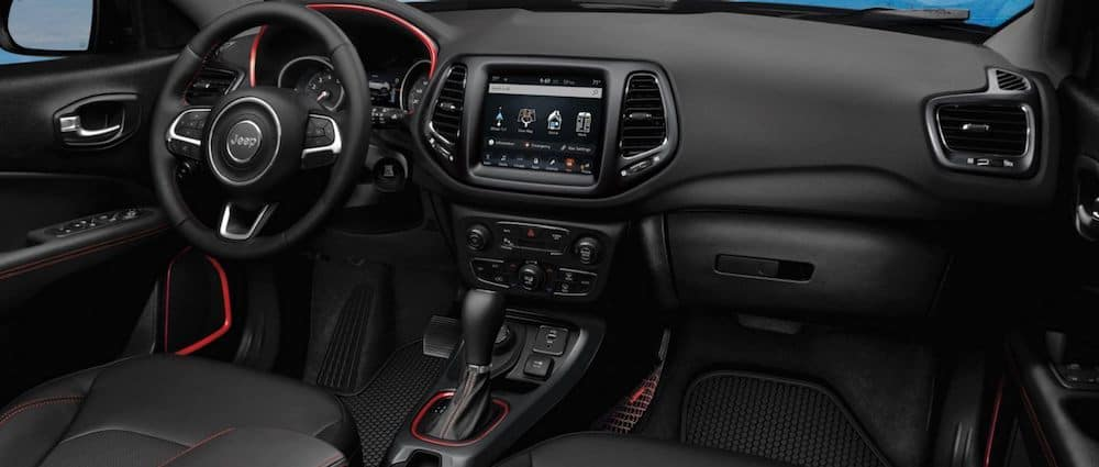 The dashboard and instrument cluster in a 2020 Jeep Compass interior