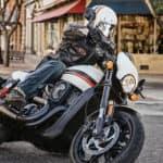 Harley Rider Turning Corner on Street