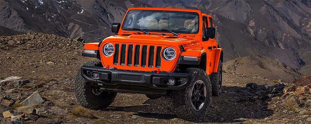 Orange 2019 Jeep Wrangler on rocky ground