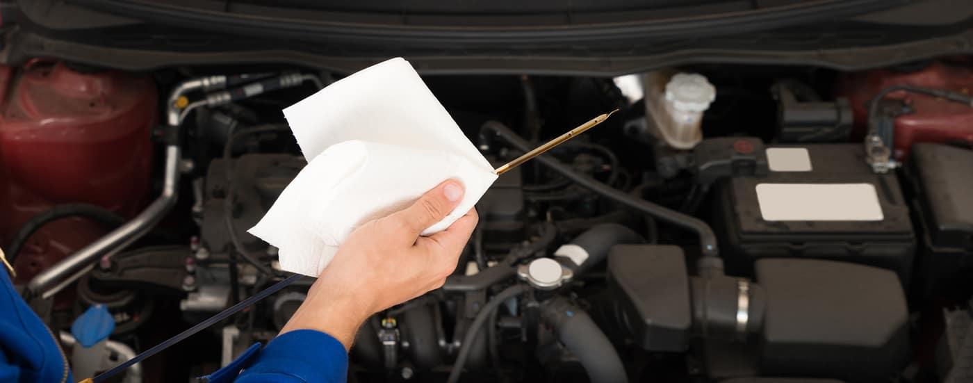 mechanic holding oil dipper
