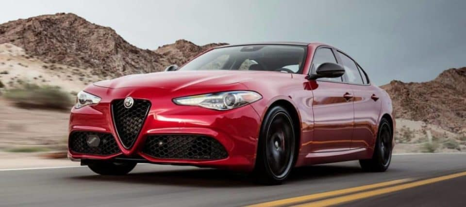 A red Giulia on a road