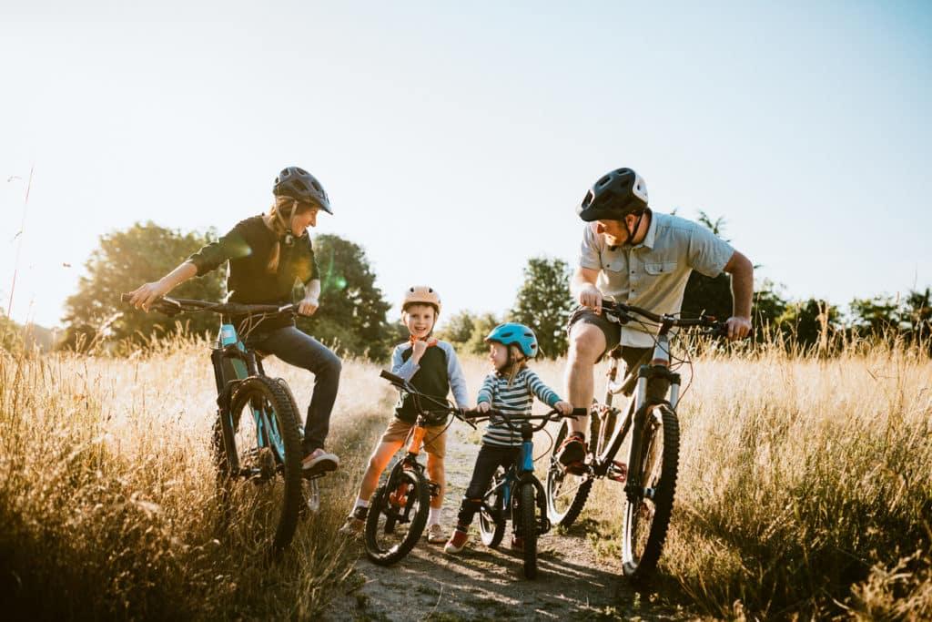 Family riding bikes on a trail