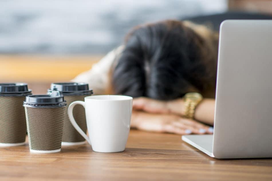 Woman struggling to stay awake at work