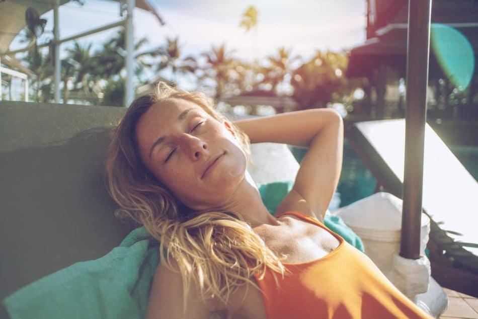 Woman sunbathing at the pool