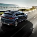 2020 Kia Sportage driving along a coastal road
