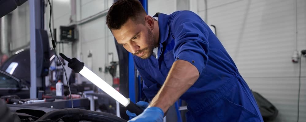 technician working on car