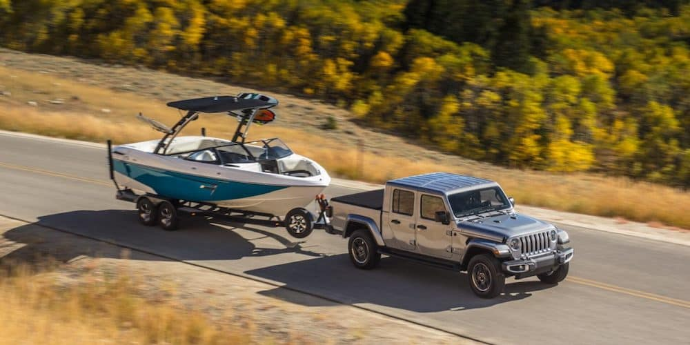 2020 Jeep Gladiator Towing Boat on Highway