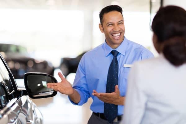 dealer shows off car