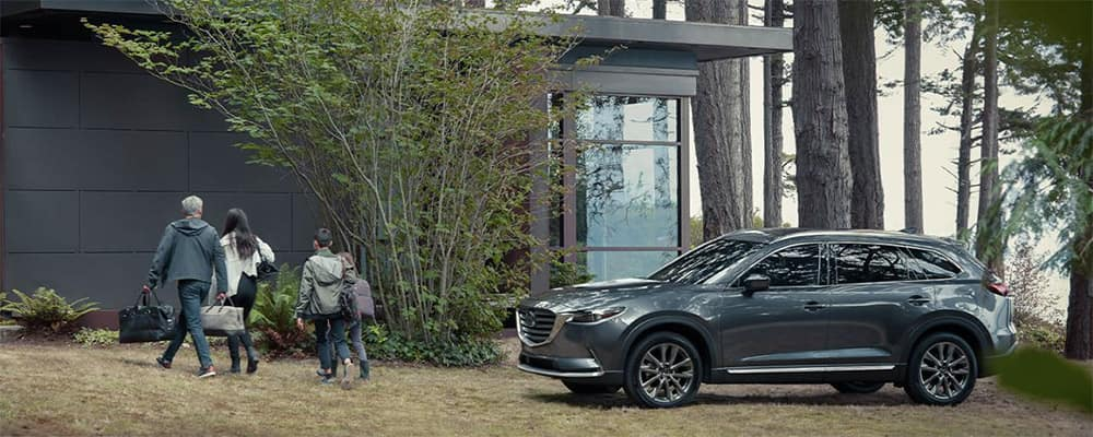 2020 Mazda CX-9 parked by house in forest