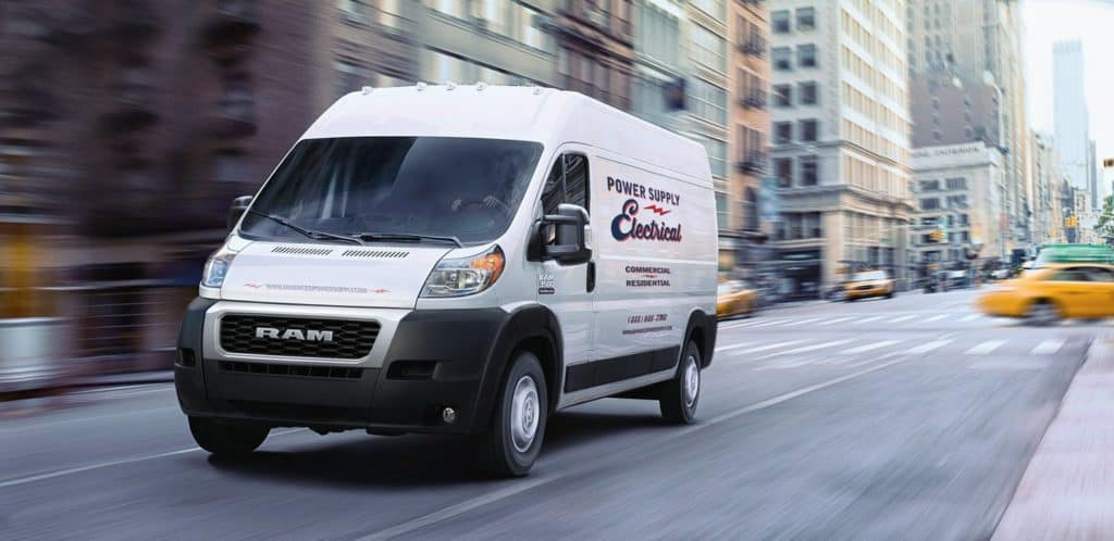 White 2020 RAM ProMaster driving down a busy San Diego street. Available now at Shaver CDJR of Thousand Oaks
