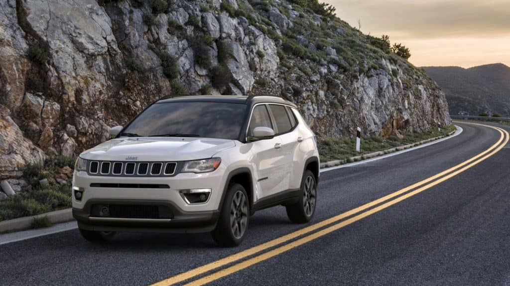 White 2020 Jeep Compass Driving Down Mountain Road. Available now at Shaver CDJR of Thousand Oaks