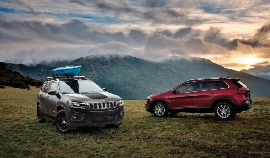 A red and black 2020 Jeep Cherokee parked on a high ridge overlooking a mountain. Available now at Shaver CDJR