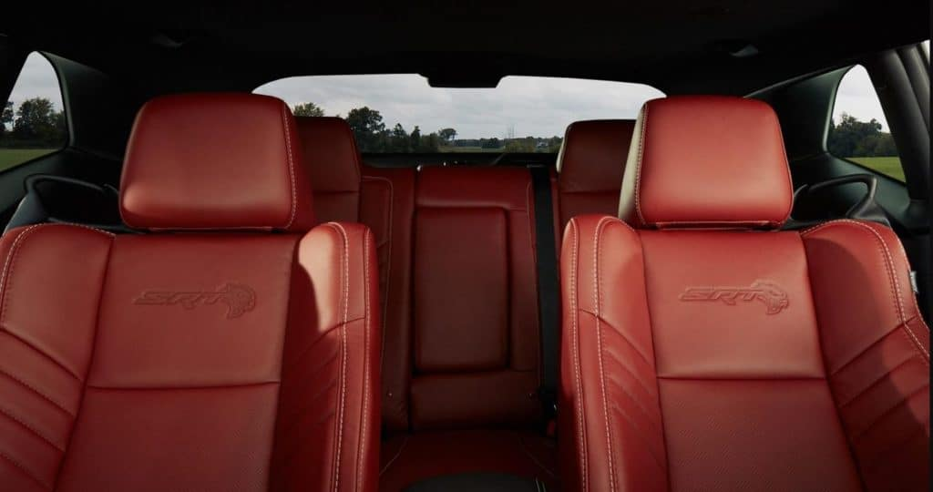 2020 Dodge Challenger interior with orange leather seats and SRT seats available now at Shaver CDJR
