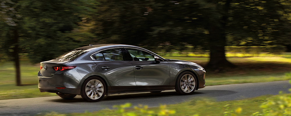 2019 Mazda3 AWD grey driving in country side