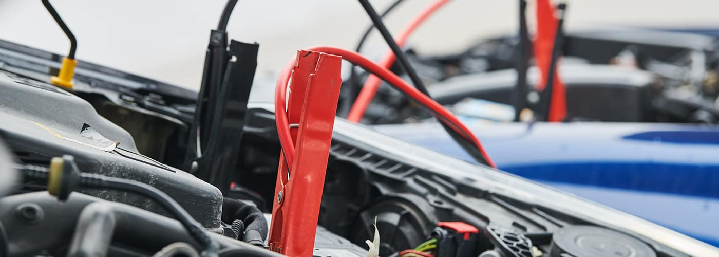 Automobile help. booster jumper cables charging automobile battery