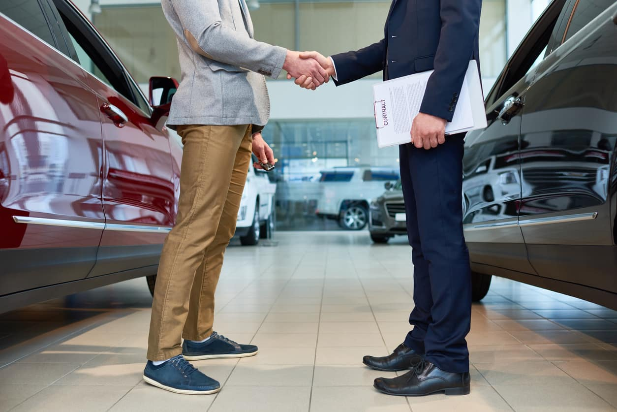 People Shaking Hands after leasing a car