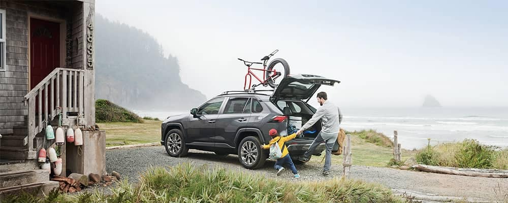 2019 Toyota RAV4 parked by lake house