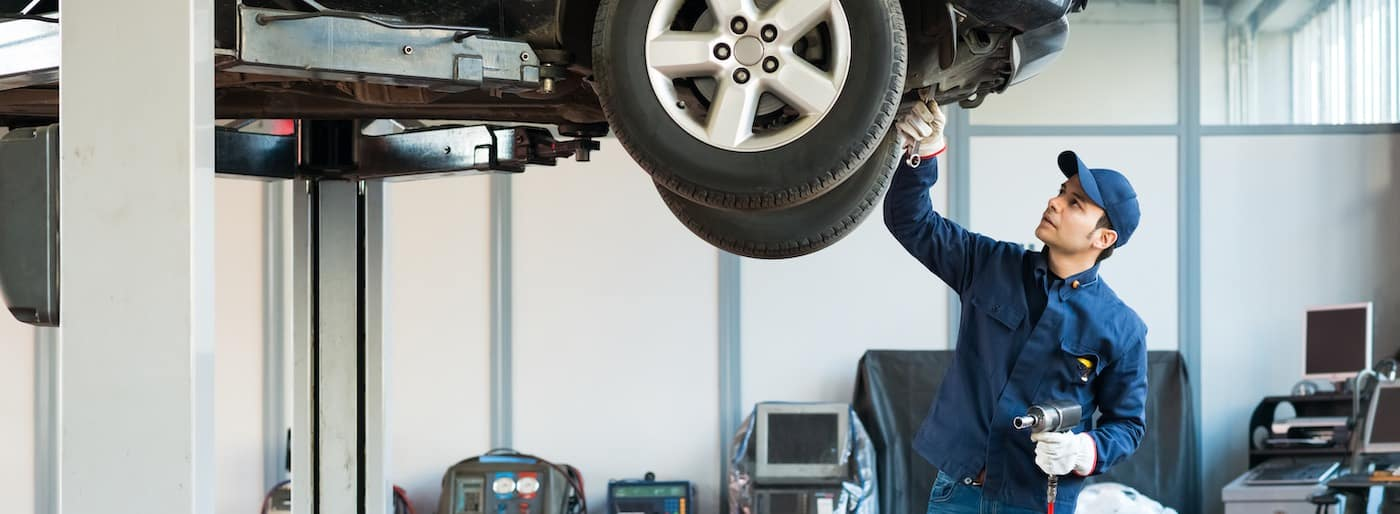 Portrait of a mechanic at work in a dealership service bay