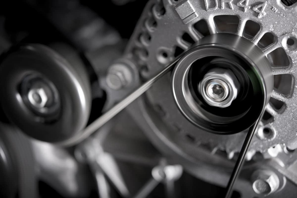 Car alternator and belt up close