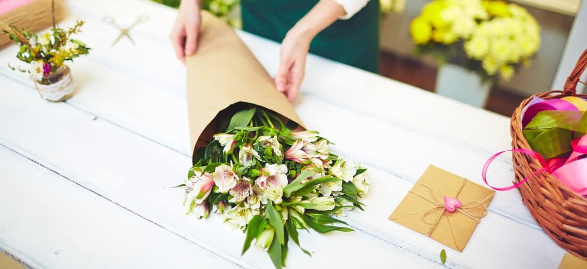 Florist prepares bouquet at floral shop