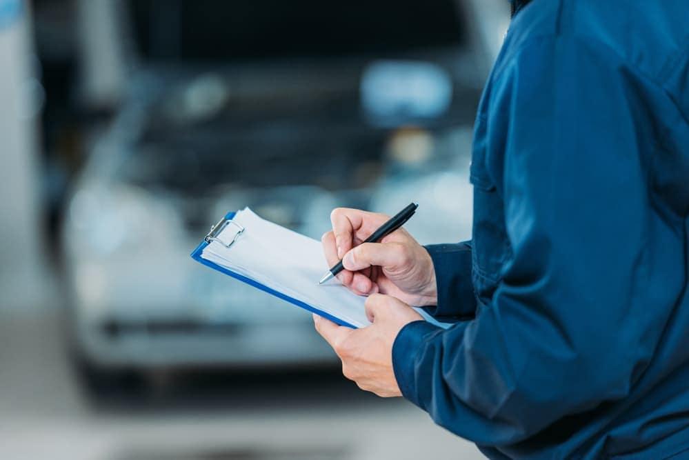Mechanic holding maintenance checklist