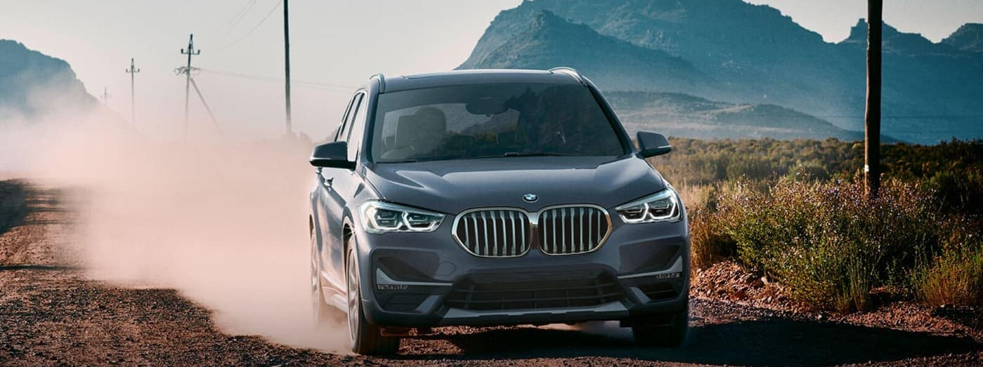 2020 BMW X1 SUV driving on dirt road
