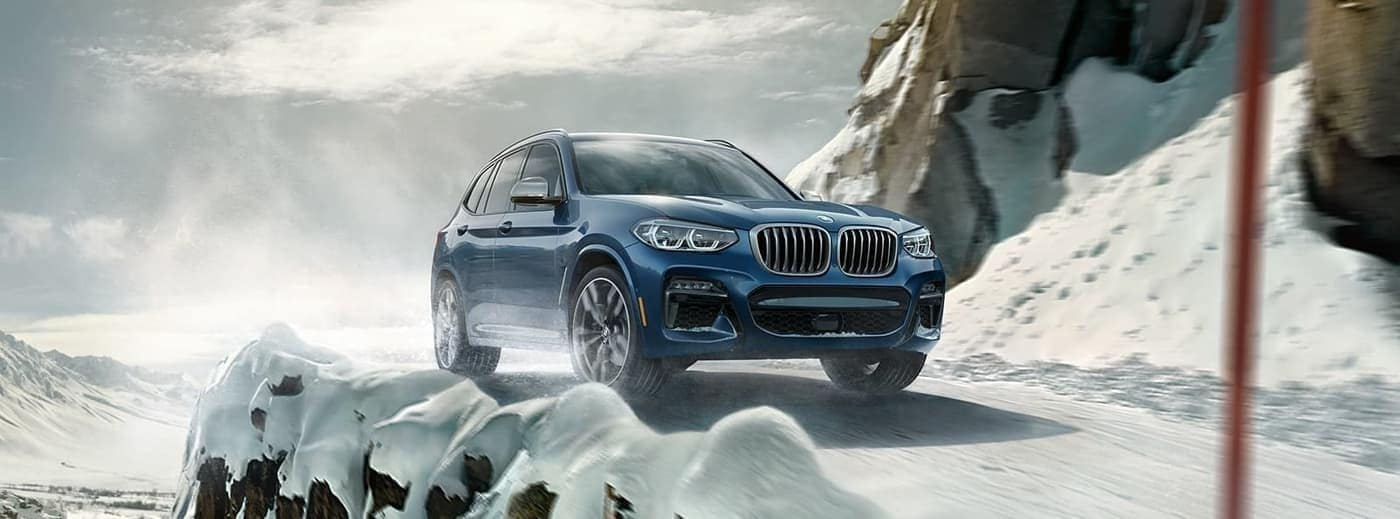 BMW X3 driving in snow