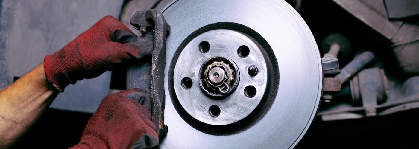 Mechanic Changing Brake Pad