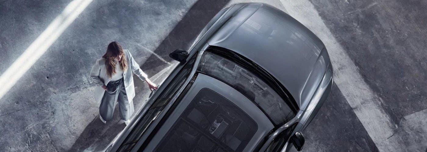 Woman Opening Volvo Door