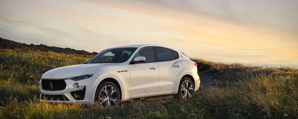 white Maserati-MY19-Levante-GTS-V8 parked in meadow at sunset