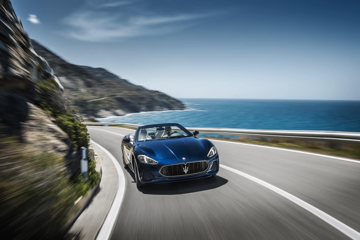 2019 Maserati GranTurismo Convertible in blue driving down curve
