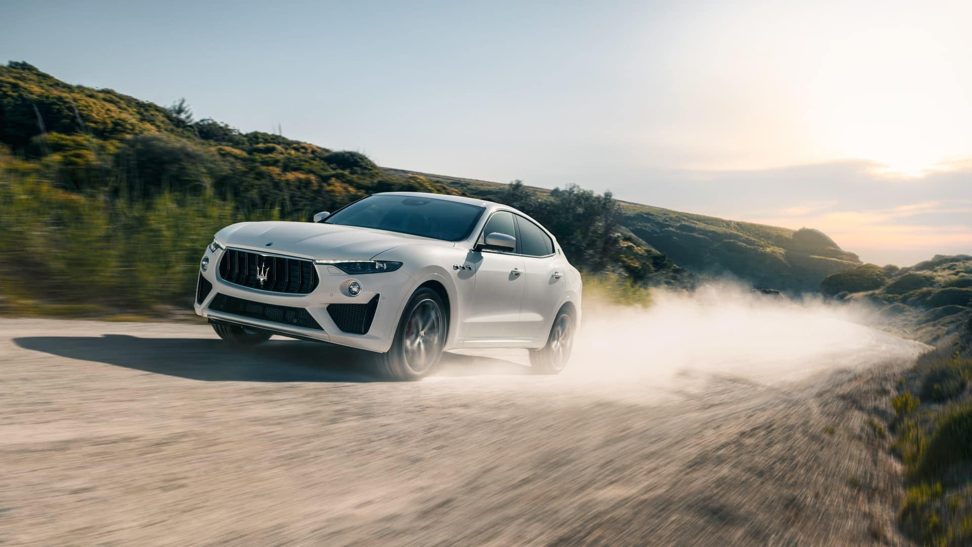 2019 Maserati Levante in white driving on trail