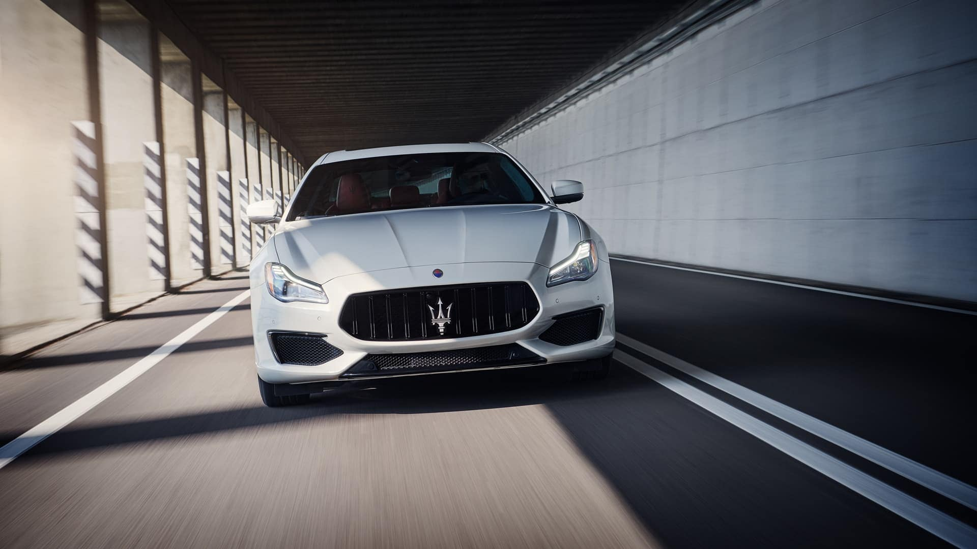 2019 Maserati Quattroporte driving down road